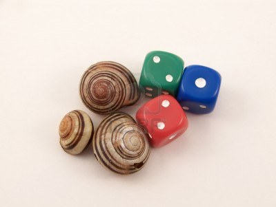 2913126-image-of-three-striped-snail-shells-and-three-die-grouped-together