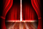 red theater stage with curtain